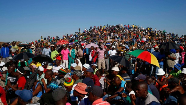 Striking miners evicted from company housing at a gold mine occupy a hill near the mine in Carltonville west of Johannesburg