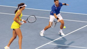 Djokovic and Ivanovic hit a return during their mixed doubles match at the Hopman Cup tennis tournament in Perth