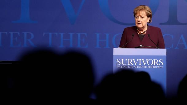 Merkel appelliert an Menschlichkeit