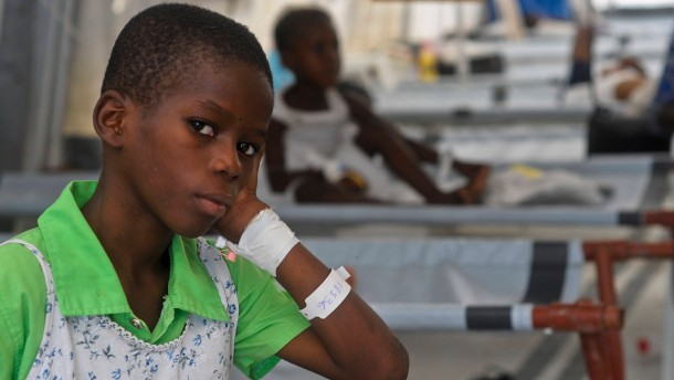 A boy diagnosed with cholera is treated at a medical center run by Medecins Sans Frontieres (Doctors Without Borders) outside of Port-au-Prince
