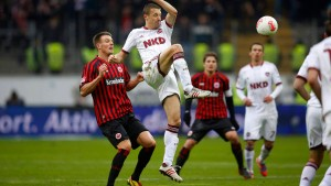 Eintracht Frankfurt's Meier challenges FC Nuernberg's Simons during their German first division Bundesliga soccer match in Frankfurt
