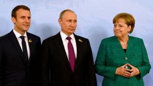 Merkel, Macron und Putin wollen Waffenruhe für Ukraine