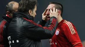 Bayern Munich's Ribery receives medical treatment during German Bundesliga first division soccer match against Hertha BSC Berlin in Berlin