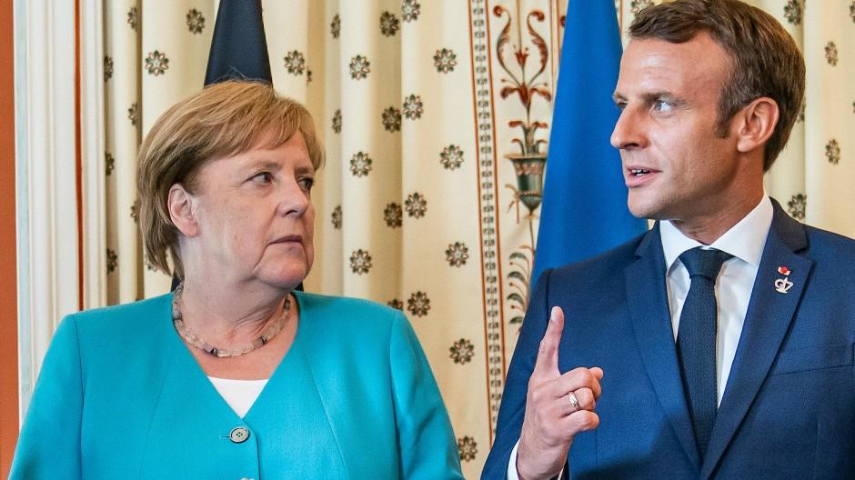 Haben derzeit ein paar Differenzen: Angela Merkel und Emmanuel Macron