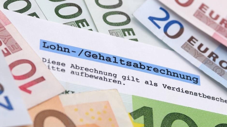 Lohn-Gehaltsabrechnung mit Geld