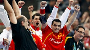 Spanish players and officials celebrate a goal of their team against Demnark during their Men's Handball World Championship final match in Barcelona