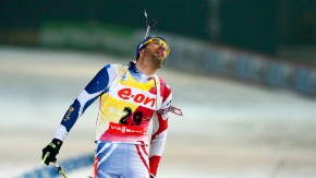 Fourcade of France reacts after crossing the finish line at the men's 20 km individual race during the International Biathlon Union World Championships in Nove Mesto