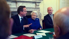 Britain's Queen Elizabeth listens during a cabinet meeting in the Cabinet Room of Number 10 Downing Street in London