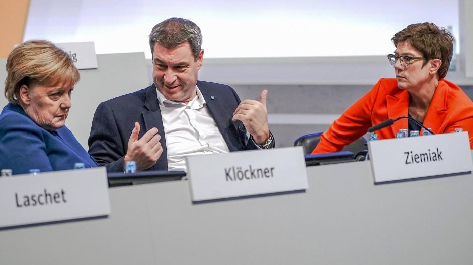 Angela Merkel, Markus Söder und Annegret Kramp-Karrenbauer beim CDU-Parteitag in Leipzig.