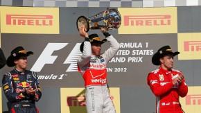 McLaren Formula One driver Hamilton holds up his trophy during the podium ceremony after the U.S. F1 Grand Prix in Austin