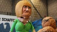 Merkel knackt harte Nüsse