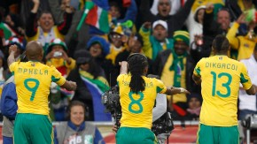 South Africa's Mphela, Tshabalala, Dikgacoi and Modise celebrate Tshbalala's goal against Mexico during the 2010 World Cup opening match in Johannesburg