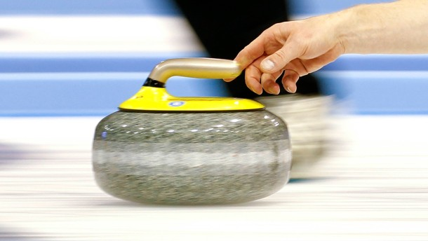 New Zealand skip de Boer delivers his stone during play against Canada at the World Men's Curling Championship 2012 in Basel