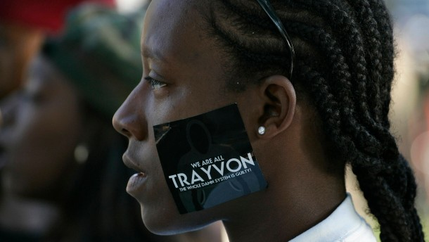 A woman wears a sticker supporting Trayvon Martin during a peaceful protest of the acquittal of George Zimmerman for the 2012 shooting death of Martin, in Los Angeles
