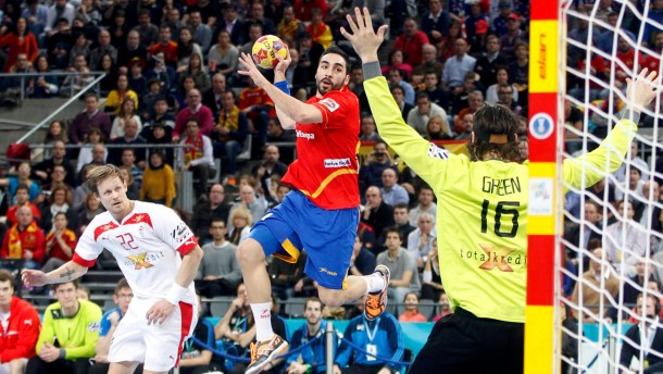Spain's Rivera challenges Denmark's goalkeeper Green Krejberg during their Men's Handball World Championship final match in Barcelona