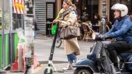 Elektrische Roller in Paris: auch nur ein weiteres Verkehrsmittel, mit dem man sich arrangieren muss