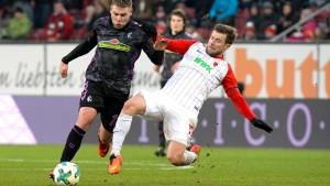 Augsburg erkämpft ein Unterschieden in letzter Minute