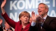 Die Kanzlerin und Röttgen beim Wahlkampfauftakt der CDU in Münster Mitte April
