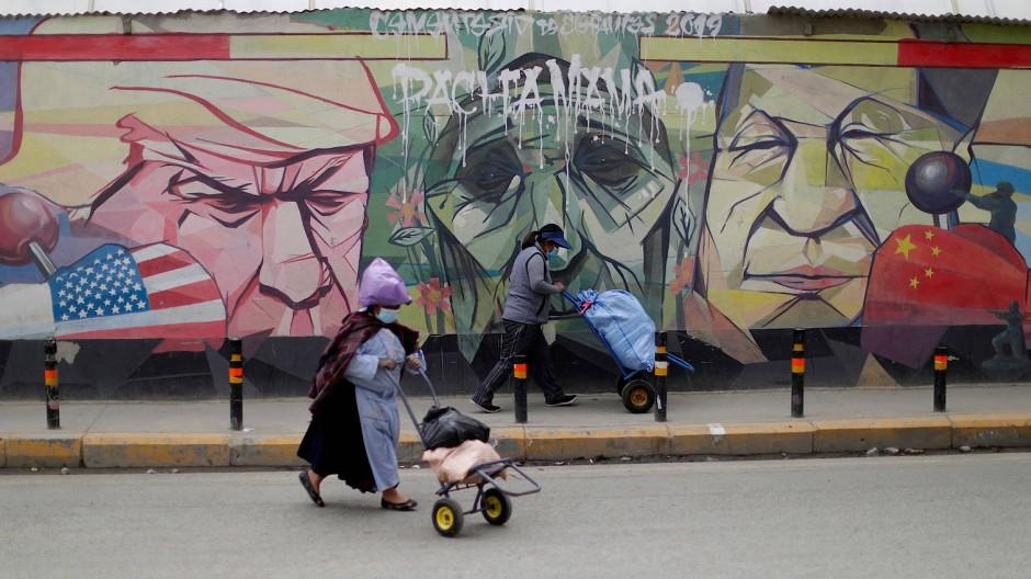 Trump gegen Xi: Ein Graffiti in El Alto, Bolivien, porträtiert den Konflikt der zwei Weltmächte.