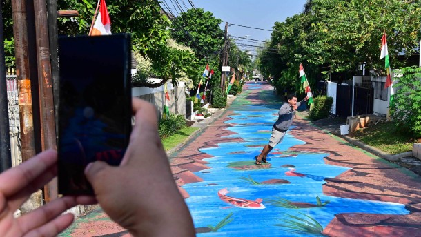 Streetart-Fluss in Jakarta wird zum Publikumsmagneten