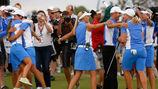 Hedwall of Team Europe celebrates with her team after holing her birdie putt on the 18th green in the singles matches to retain the 2013 Solheim Cup over Team USA at Colorado Golf Club in Parker, Colorado