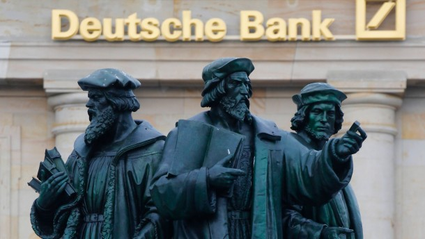 A statue is pictured in front of the former head quarters of Germany's largest business bank Deutsche Bank in Frankfurt