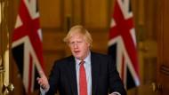 Johnson, hier bei einer Corona-Presskonferenz am Montag, steht für seine Politik gegenüber China in der Kritik.