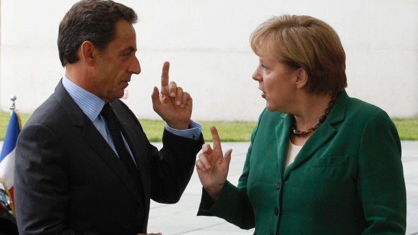 German Chancellor Merkel welcomes France's President Sarkozy before talks in Berlin