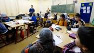 Schulklasse in Halle/Saale: Für Kinder ist dies meistens ein schwieriger Ort, weil er Fluktuation bedeutet.
