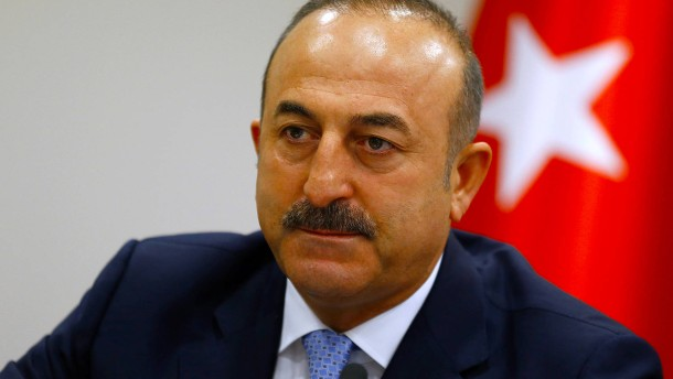 Turkey's Foreign Minister Mevlut Cavusoglu addresses the media in Ankara