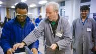 Viel Arbeit: Bei guter Integration kann Zuwanderung eine Chance für den Arbeitsmarkt sein.