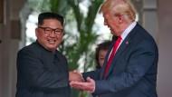 Um die Wette strahlen: Kim und Trump am Dienstag in Singapur