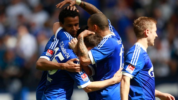 Schalke 04's players celebrate a goal against Hertha Berlin during the German first division Bundesliga soccer match in Gelsenkirchen