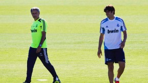 Real Madrid coach Jose Mourinho walks past Kaka during a training session at Real Madrid's training grounds in Valdebebas