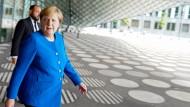 Kanzlerin Merkel: Auch wenn das Klima-Paket der Koalition am Freitag zu einem Eckpunkte-Päckchen schrumpfte, ein Scheitern konnte sich die Koalition nicht leisten.
