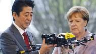 Merkel und Abe wollen auf digitale Kooperation setzen