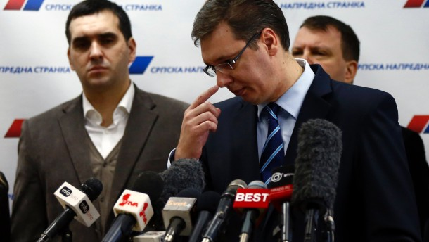 Serbian Progressive Party (SNS) leader and Serbian defence Minister Vucic gestures during a media conference in his party's headquarters in Belgrade