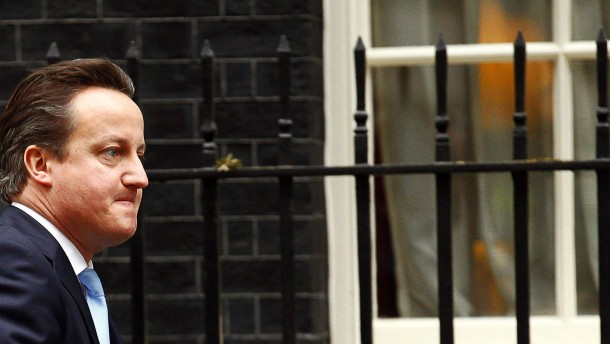 Britain's prime minister David Cameron goes to attend Prime Minis