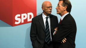Struck and Muentefering of the SPD arrives for a party executive meeting in Berlin