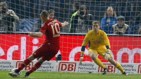 Robben of Bayern Munich scores a penalty shot past Kraft of Hertha Berlin during their first division Bundesliga soccer match in Berlin
