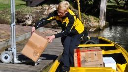 Gewinn der Post bricht um mehr als 50 Prozent ein