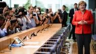 Entspannt: Angela Merkel vor ihrer Sommer-Pressekonferenz