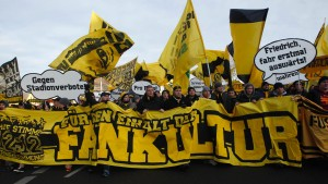 Borussia Dortmund's supporters protest before the German first division Bundesliga soccer match against Wolfsburg in Dortmund