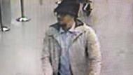 Der Mann mit Hut ist weiterhin noch nicht identifiziert – mit einem Youtube Video fahndet die belgische Polizei nach diesem Mann.