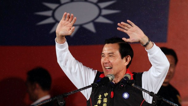 Taiwan President and Nationalist Party (KMT) presidential candidate Ma Ying-jeou celebrates after provisional election results of the Taiwan's 2012 presidential election are announced in Taipei