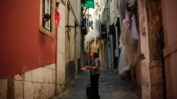 Two women talk in the Alfama neighborhood in Lisbon