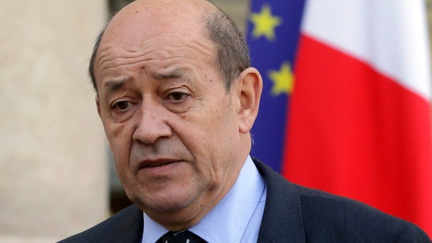 French Defence Minister Le Drian leaves the Elysee Palace in Paris following a meeting on the situation in Mali