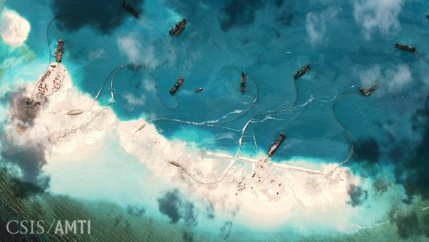 Dredging work being done along the shore of Mischief Reef located  west of the Philippine island of Palawan
