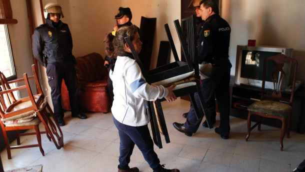 Urena carries chairs during her eviction in Madrid
