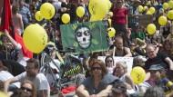 Recht oder Moral: Schweizer Bürger protestieren gegen den Versuch der Syngenta-Übernahme durch Monsanto.